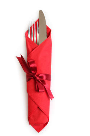 white napkin: fork and spoon in red cloth, isolated on white Stock Photo