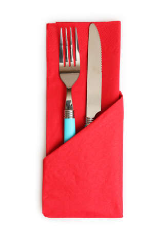 fork and spoon in red cloth, isolated on white photo