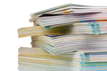 stacks of magazines isolated on white photo