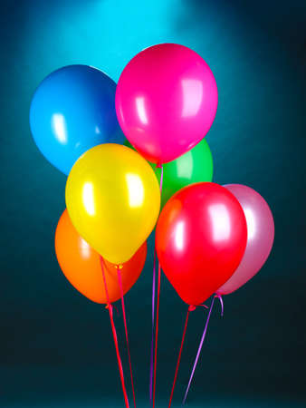 bright balloons on blue background