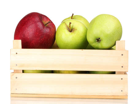 juicy apples in a wooden crate isolated on white photo