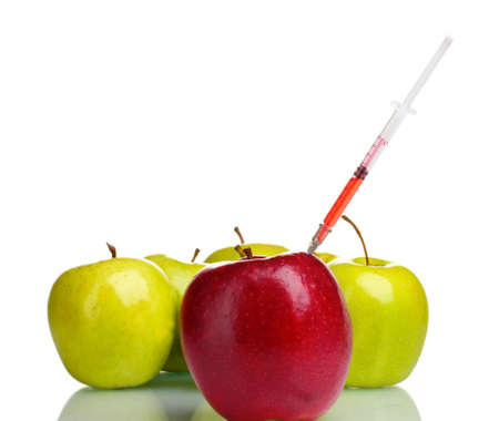 fda: red and green apples and syringe isolated on white