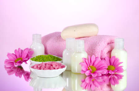 and amenities: Hotel amenities kit on pink background