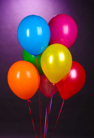 bright balloons on purole background photo