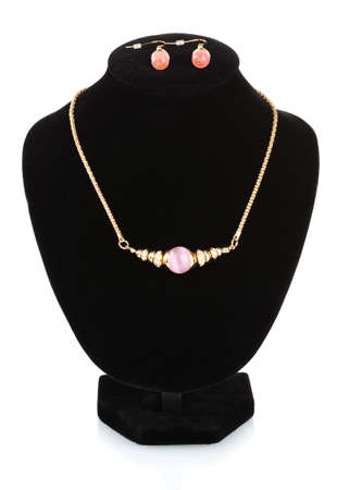 beautiful gold necklace with gem and earrings on mannequin isolated on white photo