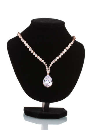 diamond necklace: beautiful gold necklace with jewels stones on mannequin isolated on white Stock Photo