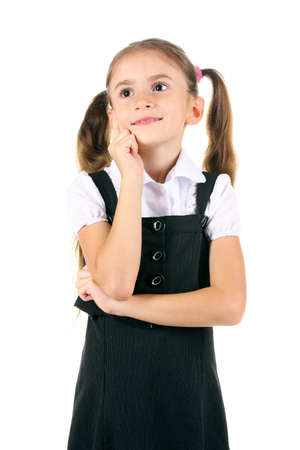 beautiful little girl in school uniform isolated on white photo