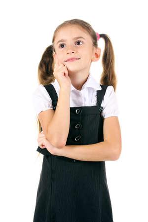 beautiful little girl in school uniform isolated on white Stock Photo - 11088501