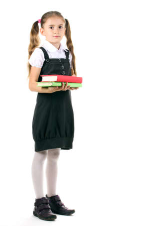 hermosa ni�a en uniforme escolar y libros aislados en blanco photo