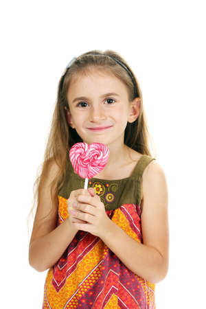 beautiful little girl and candy on stick isolated on white photo