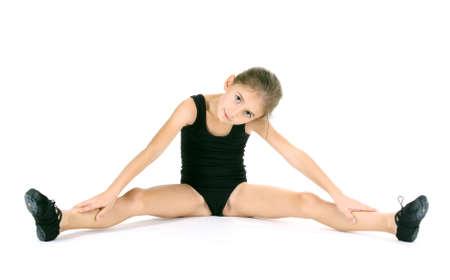 innocent: little girl ballerina, isolated on white