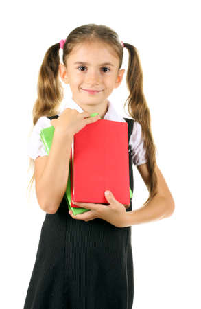 beautiful little girl in school uniform and books isolated on white photo