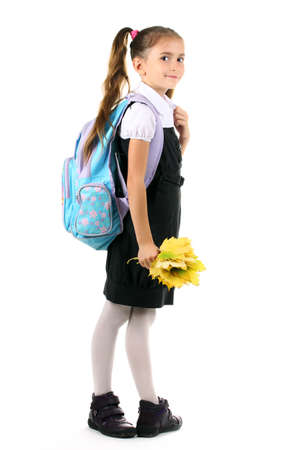 Girl School: Portrait of beautiful little girl in school uniform with backpack and autumn leaves Isolated on white