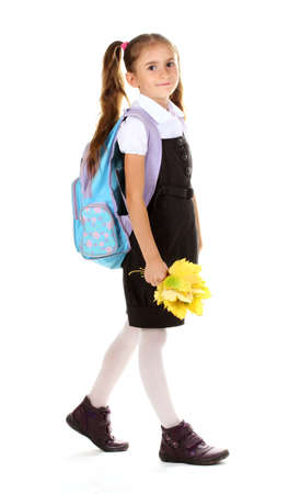 Portrait of beautiful little girl in school uniform with backpack and autumn leaves Isolated on white photo