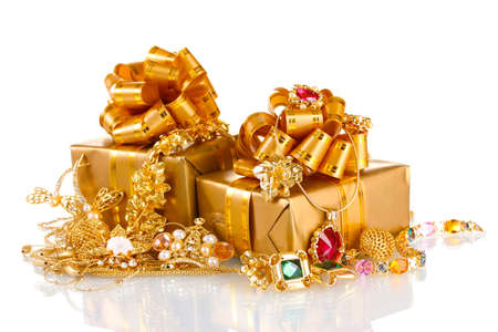 Various gold jewellery and gifts isolated on white photo