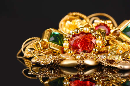 Various gold jewellery on black background Stock Photo - 11122932
