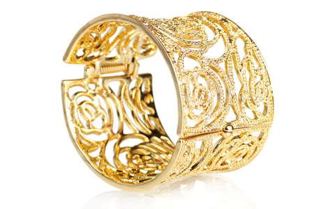 beautiful gold bracelet isolated on white photo