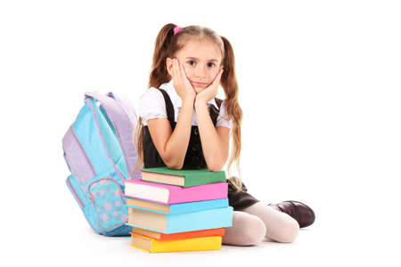 beautiful little girl, books and a backpack isolated on white Stock Photo - 11169868