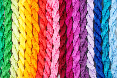 rainbow colours: sewing threads for embroidery closeup Stock Photo