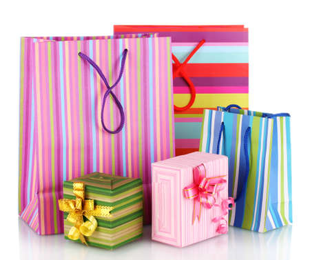 gift bag: bright gift bags and gifts isolated on white
