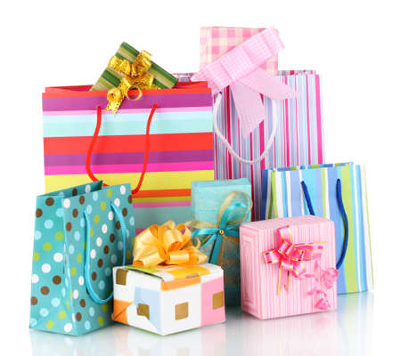 bright gift bags and gifts isolated on white Stock Photo - 11169290
