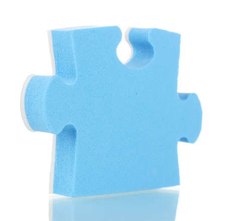 Blue puzzle closeup, isolated on white photo
