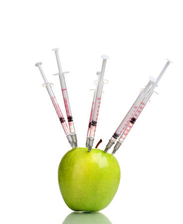 bioengineering: green apple and syringes isolated on white