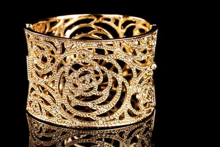 bracelet: beautiful golden bracelet on black background