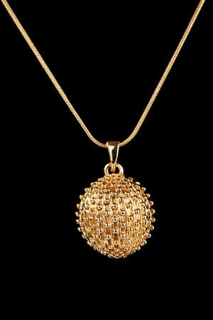 pendant: beautiful golden pendant on black background