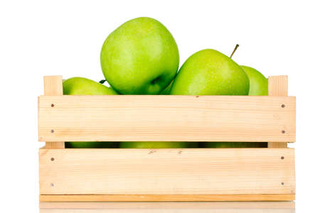 crate: juicy green apples in a wooden crate isolated on white