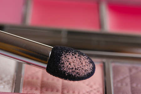 makeup set with brush closeup photo