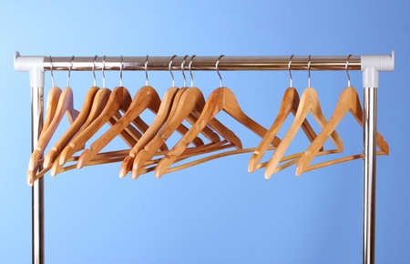 wooden clothes hangers on blue background Stock Photo - 11220623