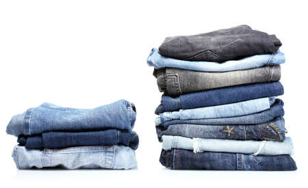 lot of blue jeans isolated on white photo