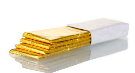 healthful: chewing gums wrapped in golden foil, isolated on white