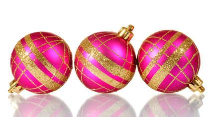 beautiful pink Christmas balls isolated on white photo