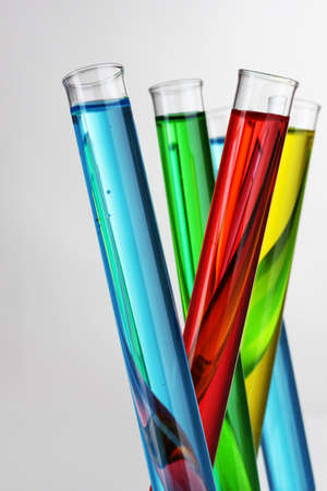 research study: Test-tubes with liquid on gray background