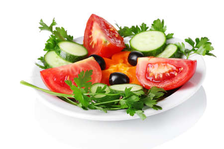 veggie tray: vegetable salad on plate isolated on white