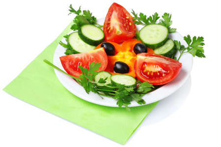 vegetable salad on plate isolated on white photo