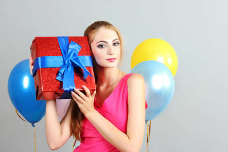beautiful young girl with a gift in hands photo