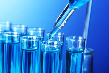 drug discovery: Test-tubes on blue background Stock Photo