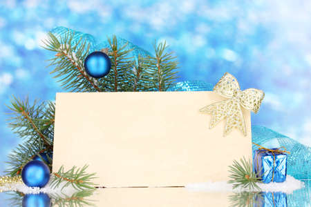 blank postcard, Christmas balls and fir-tree on blue background photo