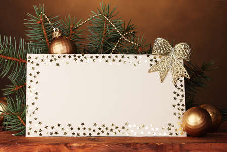 blank postcard, Christmas balls and fir-tree on wooden table on brown background Stock Photo - 11290841