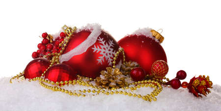 beautiful red Christmas balls and cones on snow isolated on white photo