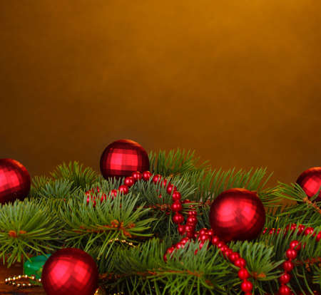 Christmas tree with beautiful New Years balls on brown background photo
