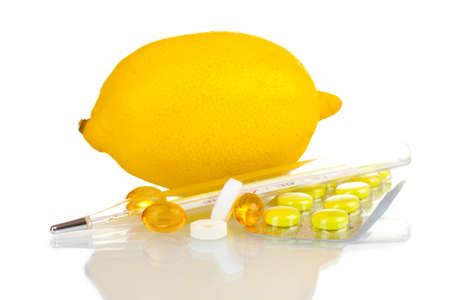 lemon, pills and thermometer isolated on white photo
