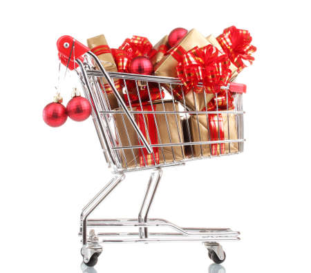 beautiful golden gifts with red ribbon and Christmas balls in  shopping cart isolated on white Stock Photo - 11337922