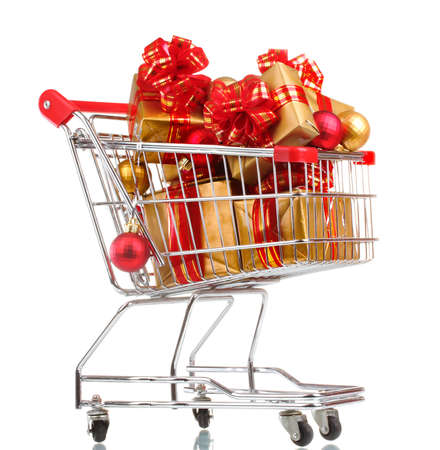 beautiful golden gifts with red ribbon and Christmas balls in  shopping cart isolated on white photo