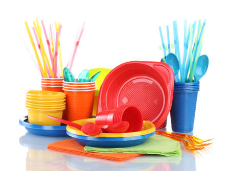 implements: Bright plastic tableware and napkins isolated on white