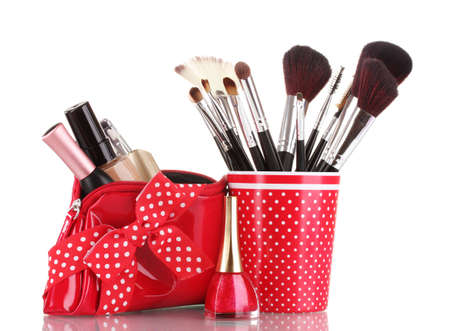 red glass with brushes and makeup bag with cosmetics isolated on white Stock Photo - 11338123
