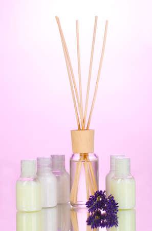 lavander: air freshener, bottles and lavander on pink background Stock Photo